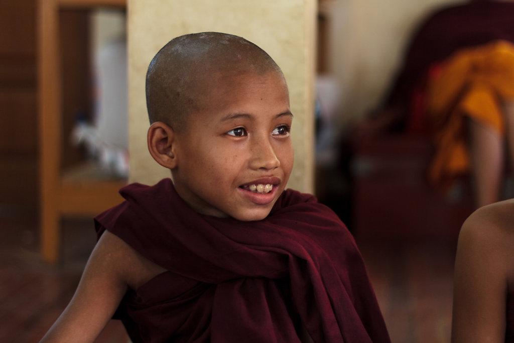 Young novice monk enjoying magic